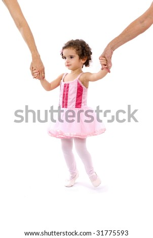 child as Ballerina holding two adults hands .