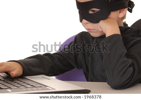 Child as costumed Zorro at laptop helpdesk