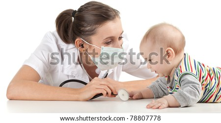 child at doctor - female doctor examining baby boy - stock photo