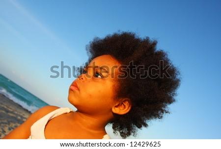 Child at the beach - stock photo
