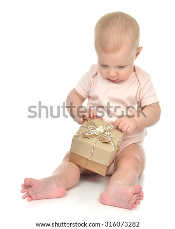 Child baby toddler kid with small rustic hand made present gift box for birthday or valentines day isolated on a white background  - stock photo