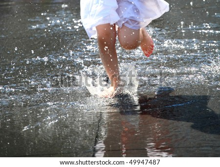 child bare feet in the water, fountain