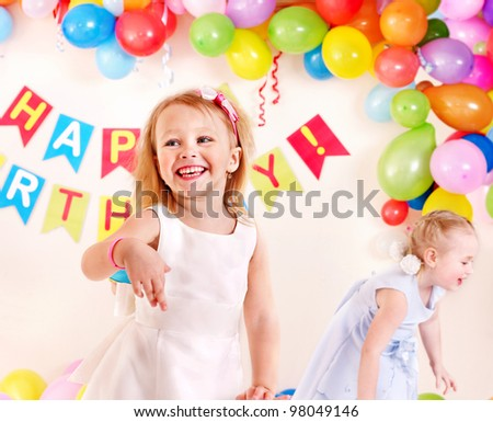 Child birthday party with happy girl. - stock photo