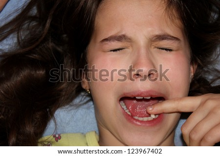 child blames tooth,best focus on the face of the child