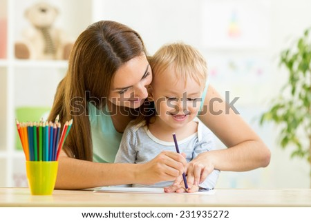 child boy and mother drawing with colorful pencils - stock photo