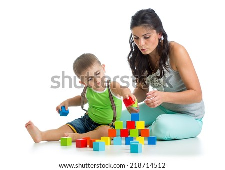 child boy and mother playing together with block toys - stock photo