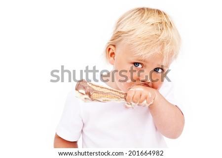 CHILD BOY EATING CHOCOLATE ICE CREAM ISOLATED ON WHITE BACKGROUND - stock photo