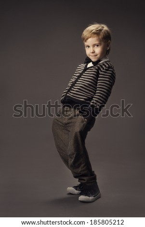 child boy fashion studio portrait, kid smart casual clothing, hand in pocket  - stock photo