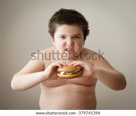 child boy kid fat burger diet eating cheeseburger - stock photo