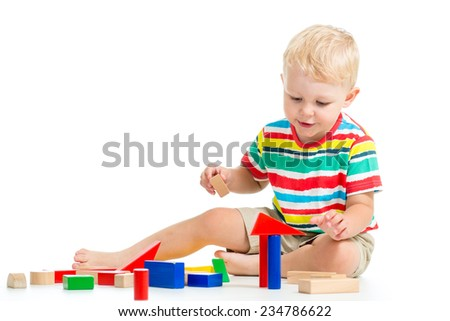 child boy playing with block toys over white background - stock photo