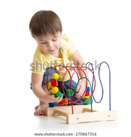 child boy playing with educational toy isolated - stock photo