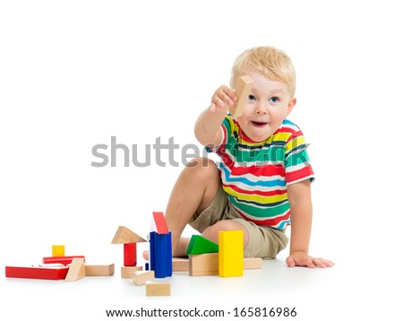 child boy playing wooden toys - stock photo