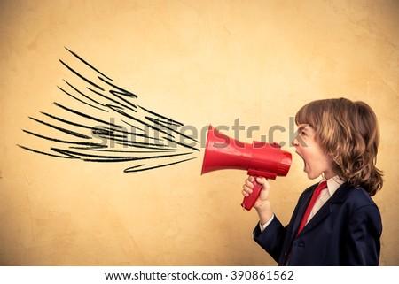 Child businessman holding megaphone. Success business communication concept - stock photo