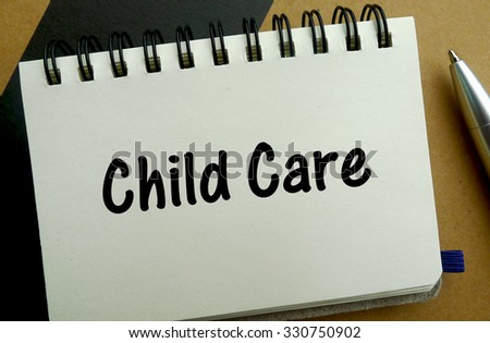 Child care memo written on a notebook with pen - stock photo