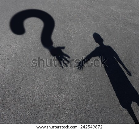 Child care question or childcare uncertainty concept as a cast shadow of a youth reaching out to a symbol for questions as a metaphor for solutions for helping children in need. - stock photo