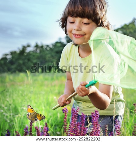 child catches a butterfly - stock photo