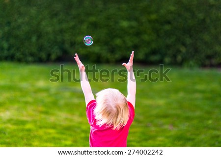 Child catching a soap bubble - stock photo