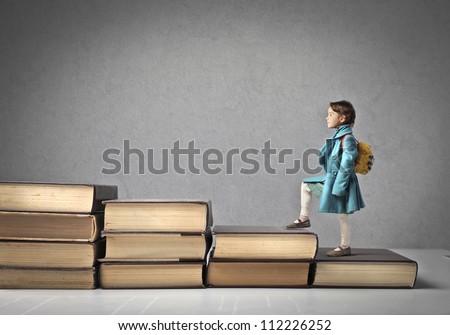 Child climbing stairs - stock photo