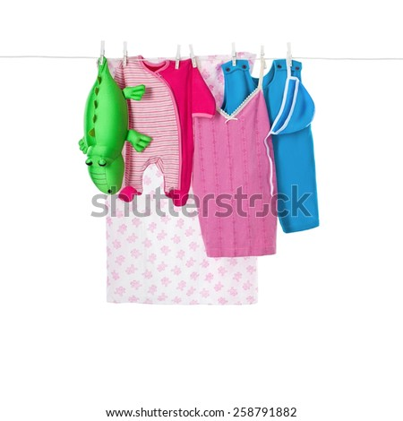 Child clothes hanging on the rope, isolated on white
