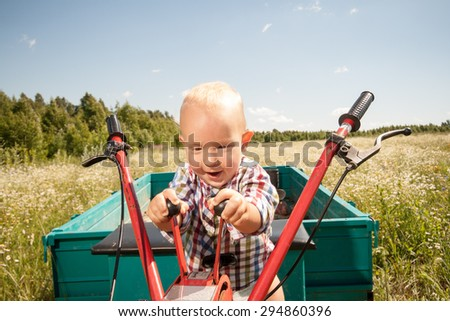 child controls the cultivator and truck
