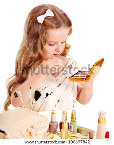 Child cosmetics. Little girl applying make up. - stock photo