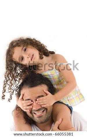 Child covering the eyes of a adult . - stock photo
