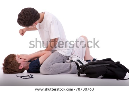 child crying on the floor child being beaten by a teenager, isolated on white, studio shot - stock photo