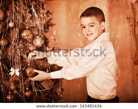 Child decorate on Christmas tree. Black and white retro. - stock photo
