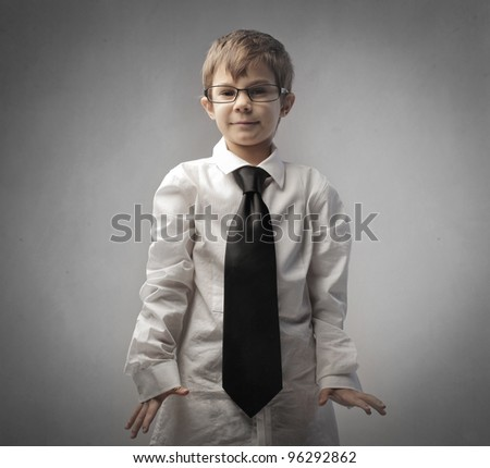 Child disguised as a businessman - stock photo