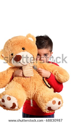 Child Doctor Listening to a Teddy Bear's Heartbeat  isolated on white - stock photo