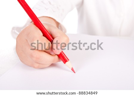 child draw picture by red color pencil - stock photo