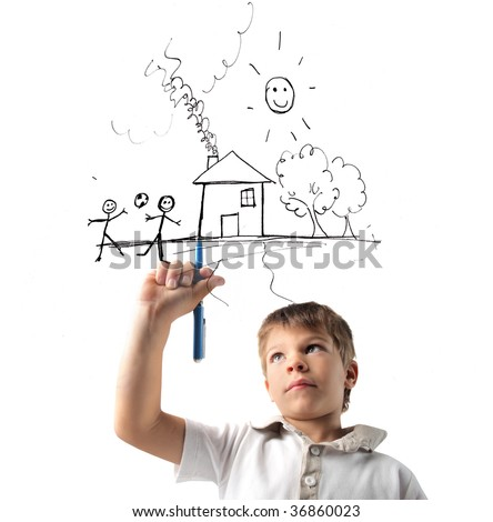 child drawing his dream of happiness - stock photo