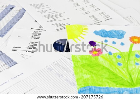 Child drawing on business financial analise reports - stock photo