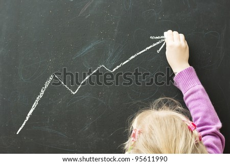 child drawing sales report on the wall, See my portfolio for more - stock photo