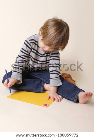 Child drawing with crayon, arts and crafts - stock photo