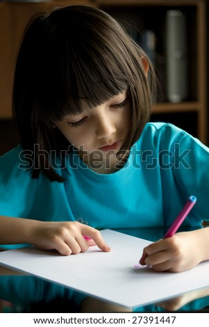 Child draws with color pens. - stock photo