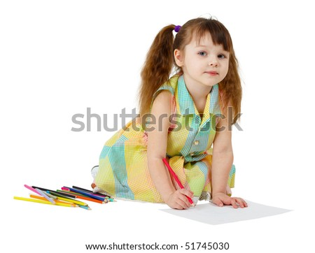 Child draws with colored pencils on the floor - stock photo