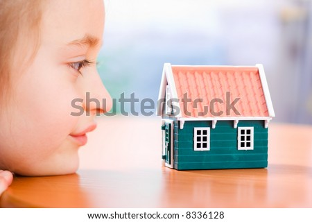 Child dreaming about a new house or home - stock photo