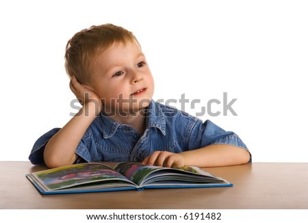 Child dreams with the book