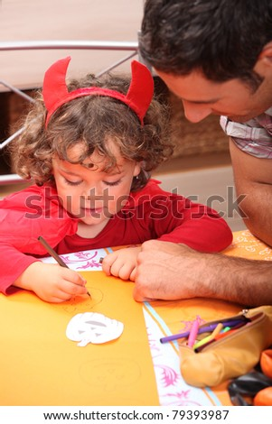 Child dressed as a little red devil for halloween - stock photo
