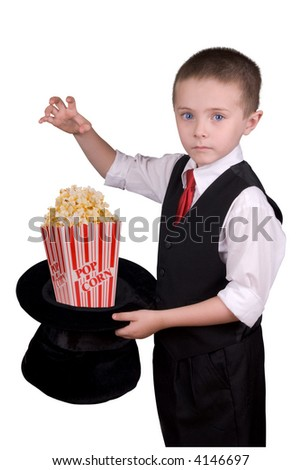 child dressed as a magician with hat full of popcorn isolated over a white background - stock photo