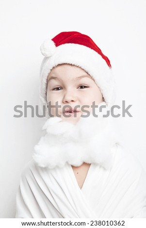 Child dressed as Santa Claus - stock photo