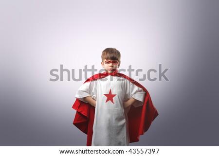 child dressed as superhero - stock photo
