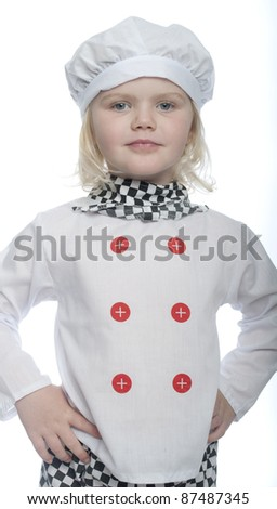 child dressed in chef costume looking directly at camera