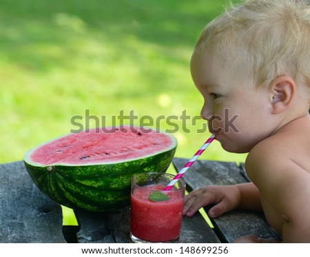 child drinking water melon smoothie