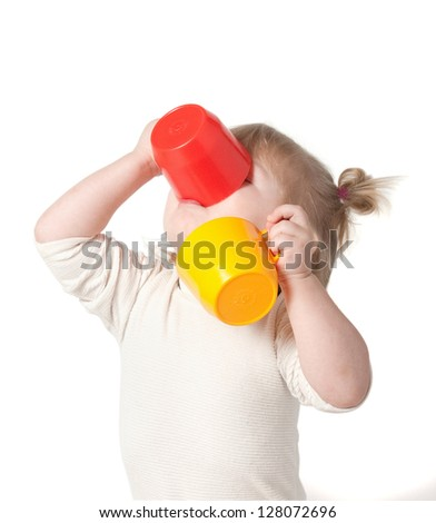 Child drinks juice from a mug. Clipping path. - stock photo