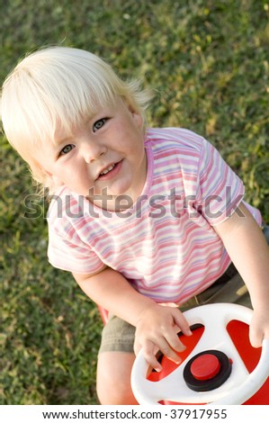 Child Driving Toy Car - Concept of Eager Learning - stock photo