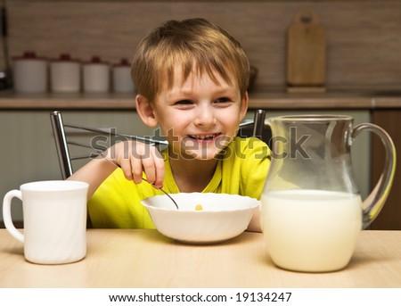 Child eating breakfast - stock photo