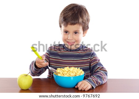 Child eating breakfast a over white background - stock photo