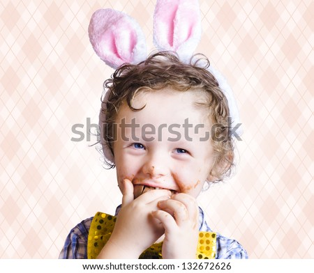 Child Eating Chocolate Easter Egg With Smile In A Easter Fun Concept On Copy Space - stock photo